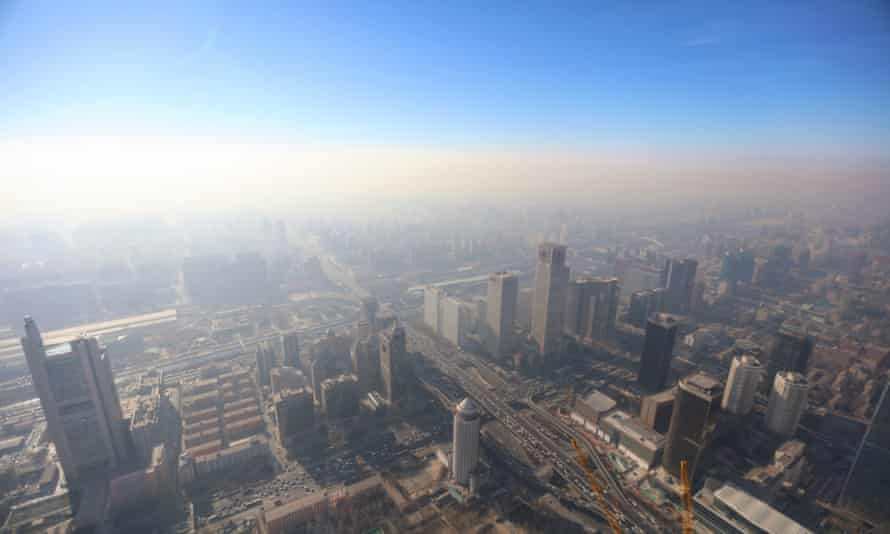 A photo taken from the China Zun, a skyscraper under construction in Beijing, shows the city being shrouded in heavy smog on Friday.