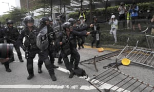 Police fire streams of pepper spray at protesters