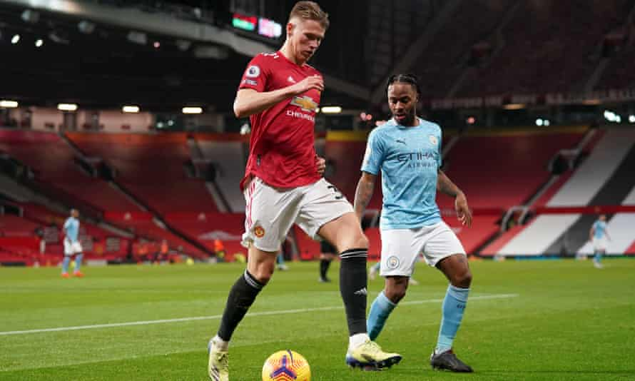 Manchester United's Scott McTominay shields the ball from Manchester City forward Raheem Sterling.