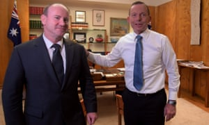 Newly appointed counter-terrorism coordinator Greg Moriarty is greeted by Tony Abbott at Parliament House on Monday.