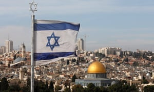 Israeli flag flies overlooking the old city of Jerusalem. Donald Trump will recognise holy city as the capital of Israel according to White House officials.