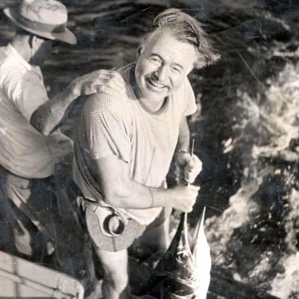 Ernest Hemingway with his catch.