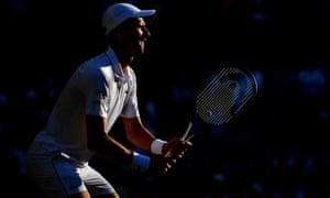 The evening sun catches Novak Djokovic during his match against Denis Kudla.