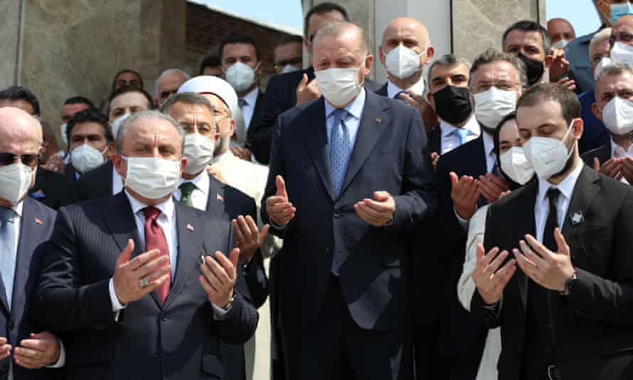 The Turkish president Recep Tayyip Erdoğan (centre) attends the opening ceremony of the Taksim mosque