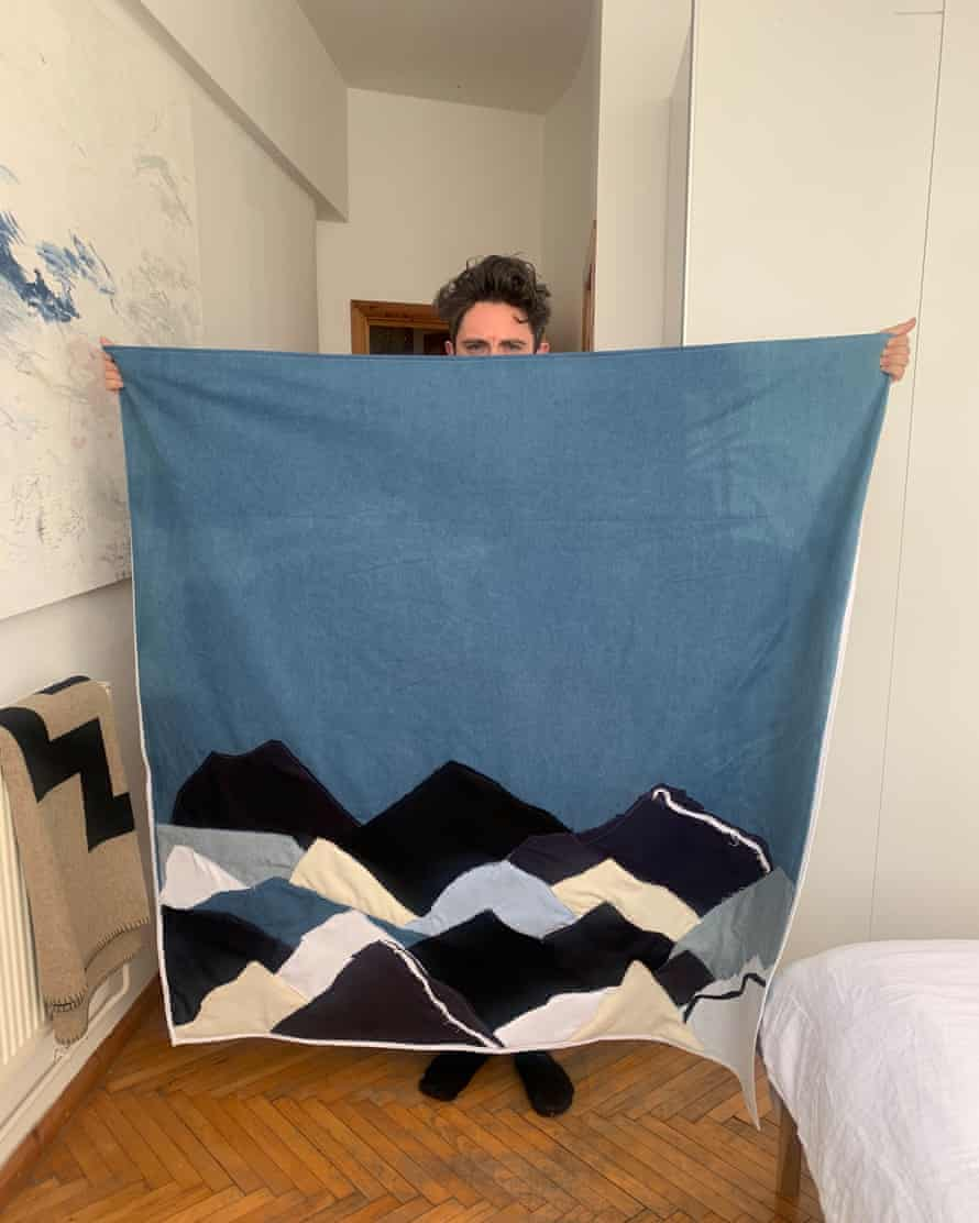 Daniel W Fletcher with his finished patchwork quilt