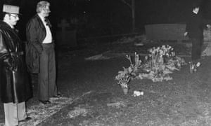 Police at the desecrated grave of English film actor and director Charlie Chaplin in the cemetery at Corsier-sur-Vevey, Switzerland, March 1978.