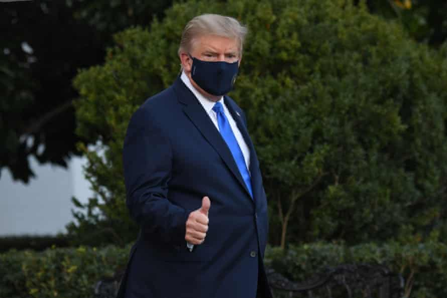 Donald Trump walks to Marine One Friday, as he heads to Walter Reed Military Medical Center after testing positive for Covid-19.