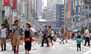 Passersby walk on a Ginza street closed off to traffic on Sundays in 2013.