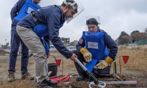 Scottish Conservative leader Ruth Davidson being given training on how to find, excavate and remove landmines by staff of the charity during her visit to Kabul.