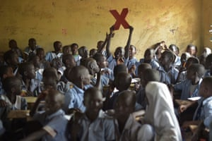 School children with the TedX logo in a classroom at their school in Kakuma camp