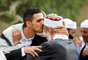Supporters of the Houthi movement in Yemen exchange greetings after prayers in Sana'a