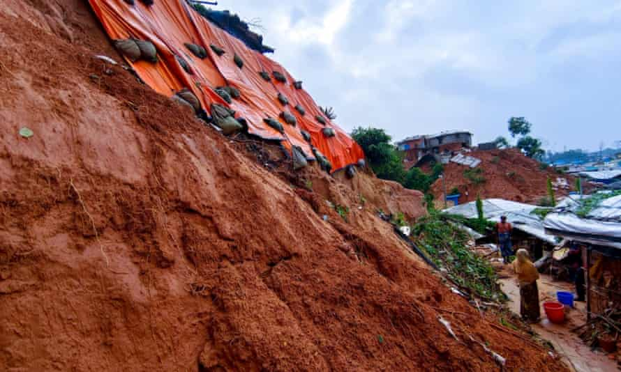 Sandbags are used to try to stabilise a hillside in one camp.