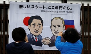 A banner shows Japan's prime minister Shinzo Abe and Russian president Vladimir Putin before their summit. The words read: 'A new start from here in Nagato.'