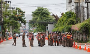 Thai police officers on security for the arrival of the rescued youth soccer team and their assistant coach at a road outside the hospital in Chiang Rai province.