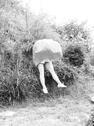 At my garden 1, from the series Until further noticeGerman photographer Isabelle Wenzel is a photographer, artist, and trained acrobat. To create her photography performance she sets her own body before the camera using a self-timer . The central focus of these often surreal photographs is the body as a physical form, rather than people themselves. By making the human being become object she draws attention to the sculptural qualities of the body.