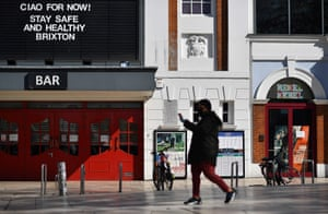A pedestrian walks past the closed Ritzy Picturehouse in Windrush Square in Brixton, south London.