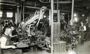 Typesetters working on Linotype machines in the composing room of the Manchester Guardian's offices in Cross Street, Manchester, May 1921.