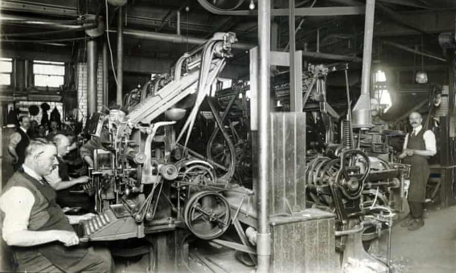 Typesetters working on Linotype machines in the composing room of the newspaper's offices in Cross Street, Manchester, May 1921