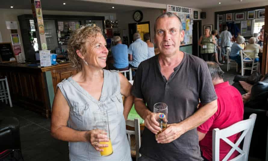 Helen Jones and Warren Carter, Bevy stalwarts, in the pub with bar and regulars behind