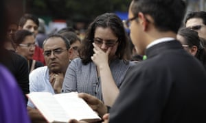 A priest holds an outdoor Catholic Mass near the collapsed Enrique Rebsámen school.