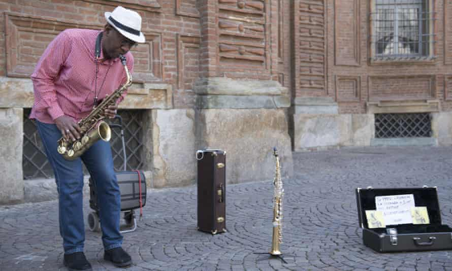 A street jazz musician performs in Piazza Carignano, Turin, Italy last week.