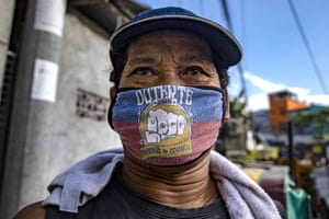 Quezon, Philippines A man is seen wears a President Duterte mask with his election campaign slogan in Quezon city
