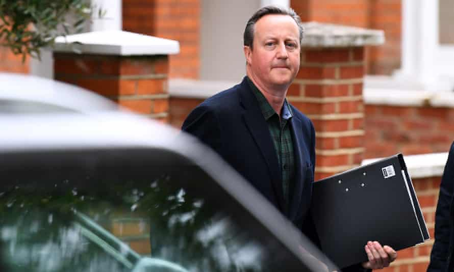David Cameron leaves his house ahead of his appearance before MPs.