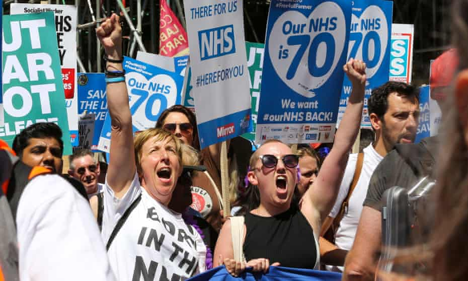 Actor Julie Hesmondhalgh (L) joins thousands of doctors, nurses, campaigners, unions and NHS supporters at the London rally.