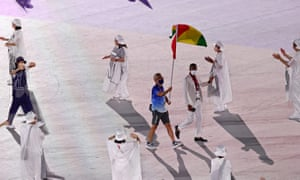 A member of Team Guinea attends the Opening Ceremony on Friday.