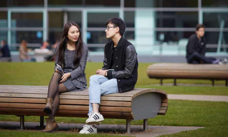 students chat between lessons in the grounds of the University