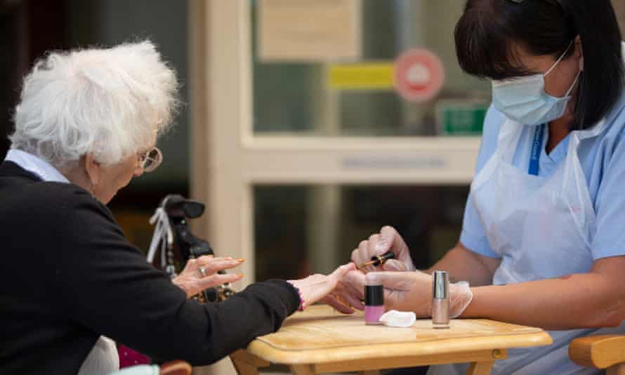 Jane Ross, 88, has her nails done by care worker Debra Wright at Eskgreen care home in Musselburgh.