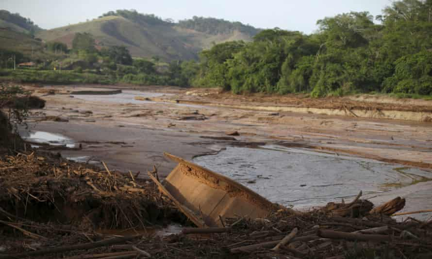 A boat is pictured in Rio Doce after a dam, owned by Vale SA and BHP Billiton Ltd burst, in Santa Cruz do Escalvado.