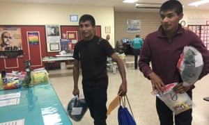 Guatemalan aslyum seekers arrive at a shelter in McAllen, Texas