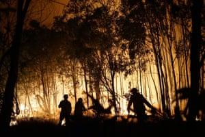 Firefighters battle a blaze on the Fingerfield road at the Deepwater national park.