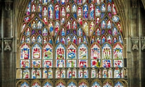 A recent Eyewitness photo: a workman in front of the newly restored Great East Window in York Minster.
