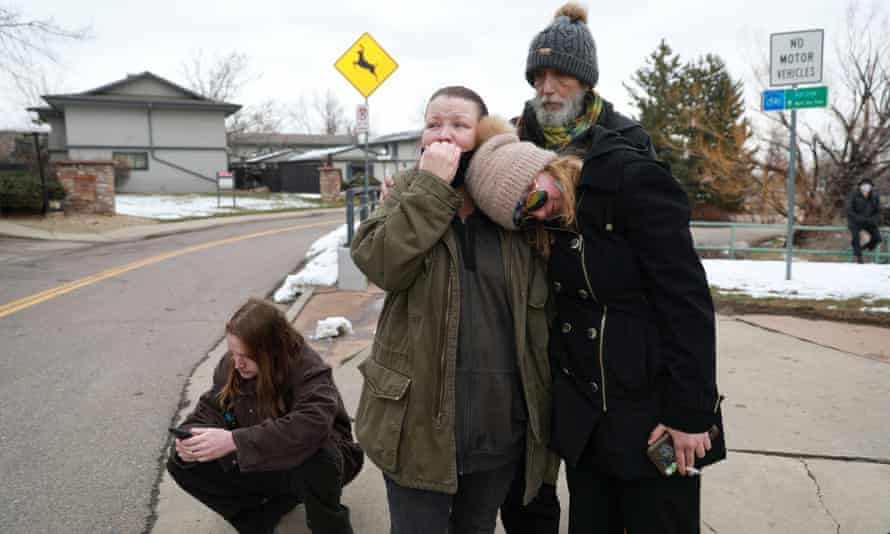 Sarah Moonshadow is comforted by David and Maggie Talley after Moonshadow was inside King Soopers grocery store during a shooting.