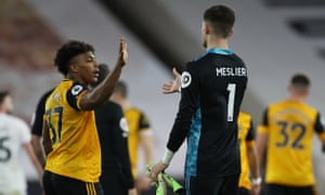 Wolves' Adama Traore and Leeds' Illan Meslier shake hands at the end.