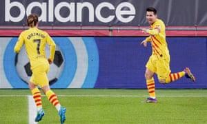 Lionel Messi celebrates with Antoine Griezmann after scoring for Barcelona.