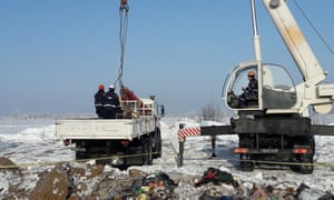 Emergency workers at site of Sunday's plane crash in Ramensky