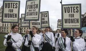 Women dressed as suffragettes mark the 100th anniversary of the Representation of People Act 1918 in London on 6 February 2018