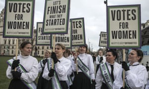 Women dressed as suffragettes celebrate the centenary of the Representation of People Act 1918.