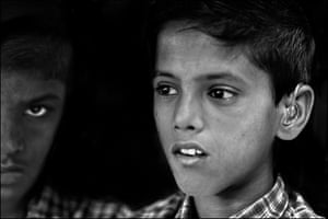 Ankit Kureel (foreground) and Adeeb Ali at the Chigari Trust clinic in Bhopal. Ankit was born with severely impaired hearing. His father survived exposure to the gas cloud. Doctors believe Ankit's hearing was genetically affected by his father's medical history. Adeeb has mental development issues and suffers from ADHD. His mother survived exposure to the gas, and doctors believe his development issues are genetically linked to his mother's medical history.