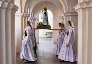 Women carry a statue of the Virgin Mary during a procession in Rosenthal, Germany