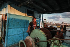 Fisherman Said Abu Odeh, 24, photographed onboard his boat in Gaza City.