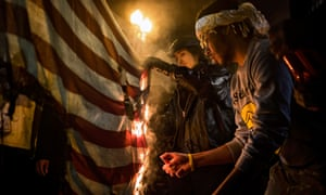 Burn, baby, burn … protesters set fire to a US flag in Washington, 2014.