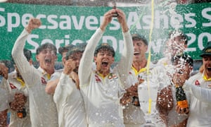Australia lift the urn after retaining the Ashes.