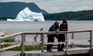 An iceberg floats near the seashore of King's Point in Newfoundland, Canada.