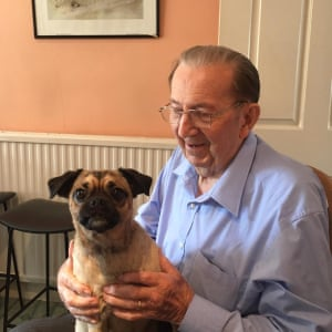 Alan Sigsworth with his granddaughter's dog at his home in Norfolk, in 2019.