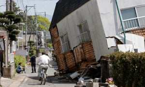 A collapsed house on a street in Mashiki after Thursday's earthquake