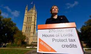 A demonstrator protesting against cuts to tax credits outside parliament last year.